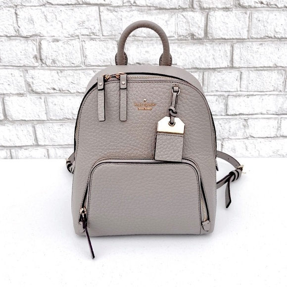 kate spade Handbags - Kate Spade Small Grey Pebbled Leather Backpack